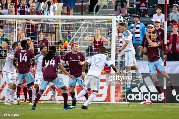 Christian Ramirez of Minnesota United heads ball towards goal against the Colorado Rapids at Dick's Sporting Goods Park on June 23 2018 in Commerce...