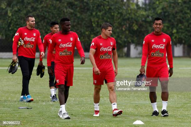 Christian Ramos Aldo Corzo and Renato Tapia of Peru walk into the field during a training session ahead of FIFA World Cup Russia 2018 on May 25 2018...