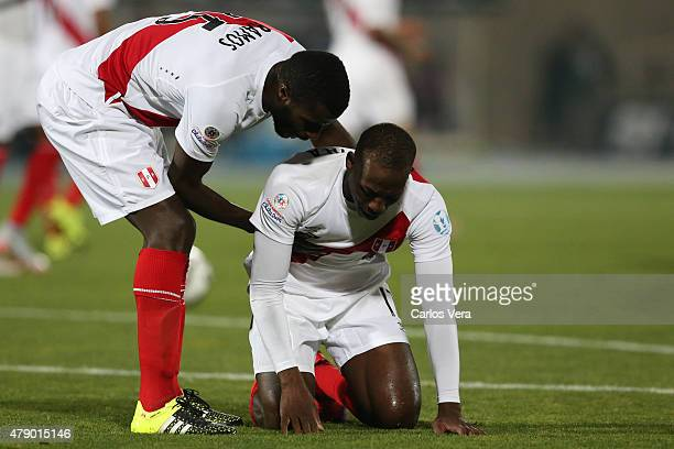 Christian Ramos helps his teammate Luis Advincula of Peru after the 2015 Copa America Chile Semi Final match between Chile and Peru at Nacional...