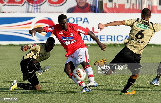 Christian Ramos of Juan Aurich fights for the ball with Erwin Maturana of Itagui during a match between Juan Aurich and Itagui as part of The Copa...