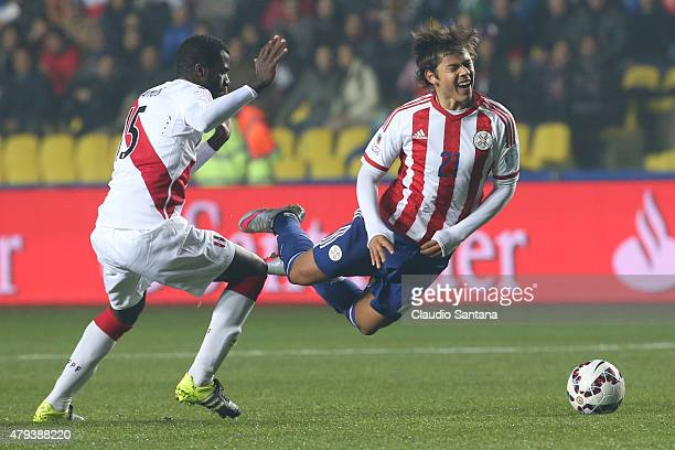 Christian Ramos of Peru fights for the ball with Oscar Romero of Paraguay during the 2015 Copa America Chile Third Place Playoff match between Peru...