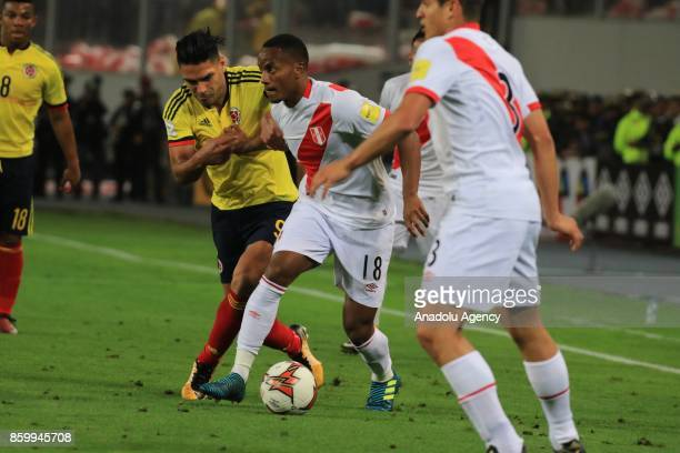 Christian Ramos of Peru in action against Radamel Falcao of Colombia during the 2018 FIFA World Cup Qualification match between Peru and Colombia at...