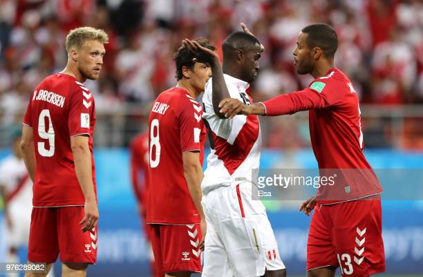 Christian Ramos of Peru reacts as Mathias Jorgensen of Denmark speaks during the 2018 FIFA World Cup Russia group C match between Peru and Denmark at...