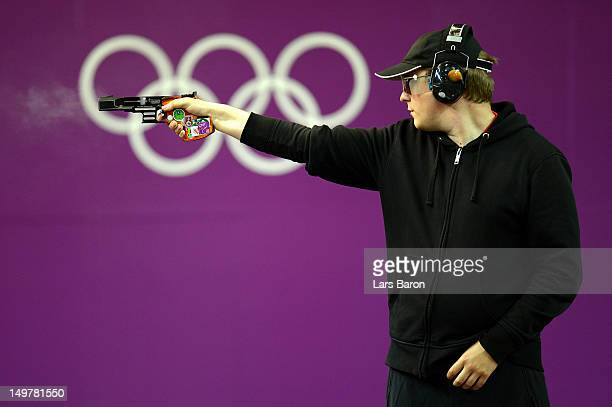 Christian Reitz of Germany competes in the Men's 25m Rapid Fire Pistol Shooting final on Day 7 of the London 2012 Olympic Games at The Royal...