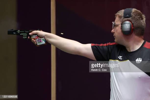 Christian Reitz of Team Germany waves his arm during warmups before the 25m Rapid Fire Pistol Men's Qualification on day nine of the Tokyo 2020...