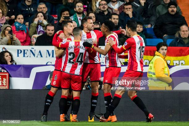 Christian Ricardo Stuani Curbelo of Girona FC celebrates after scoring his goal with teammates during the La Liga 201718 match between Real Madrid...