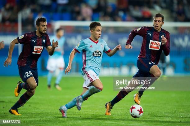 Christian Rivera of SD Eibar duels for the ball with Emre Mor of RC Celta de Vigo during the Copa Del Rey match between Eibar and RC Celta de Vigo at...