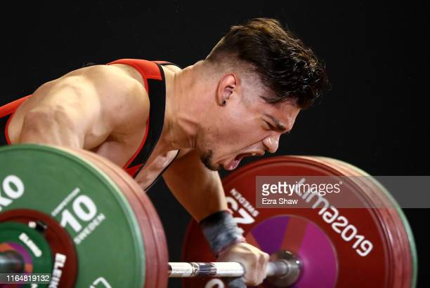 Christian Rodriguez Ocasio of the United States reacts after a lift in the men's weightlifting 81kg competition on Day 2 of the Lima 2019 Pan...