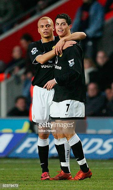 Christian Ronaldo of Manchester United is congratulated by Wes Brown after scoring during the FA Cup quarterfinal between Southampton and Manchester...
