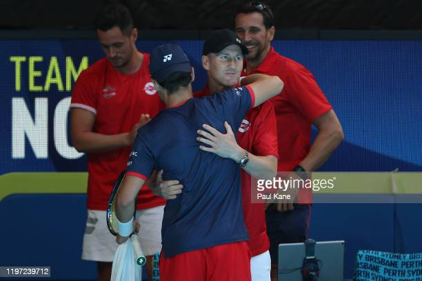 Christian Ruud, captain of Team Norway congratulates Casper Ruud after defeating John Isner of Team USA during day one of the 2020 ATP Cup Group...