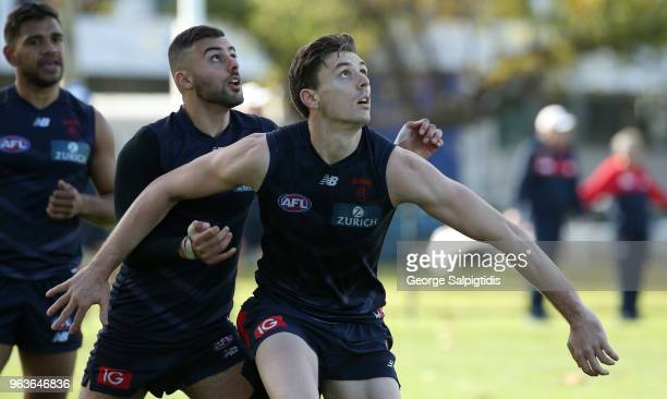 Christian Salem and Jake Lever of the Demons are seen during a Melbourne Demons training session at Gosch's Paddock on May 30 2018 in Melbourne...