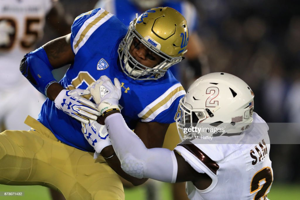 Christian Sam #2 of the Arizona State Sun Devils tackles Jordan Wilson #87 of the UCLA Bruins during the first half of a game at the Rose Bowl on November 11, 2017 in Pasadena, California.