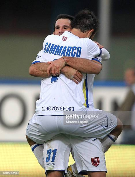 Christian Sammarco of Chievo celebrates his team's second goal with his team-mate Sergio Pellisier during the Serie A match between Catania Calcio...