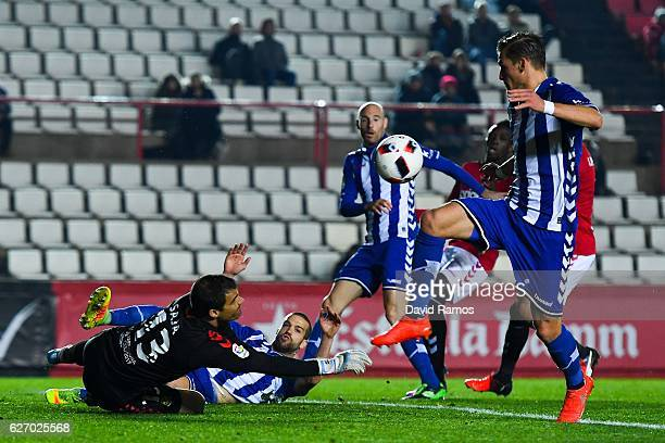 Christian Santos of Deportivo Alaves scores his team's third goal during the Copa del Rey round of 32 first leg match at Nou Estadi on December 1...