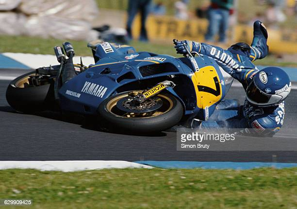 Christian Sarron of France drops the Gauloise Sonauto 500cc SonautoYamaha YZR500 during the British 500cc motorcycle Grand Prix on 6 August 1989 at...