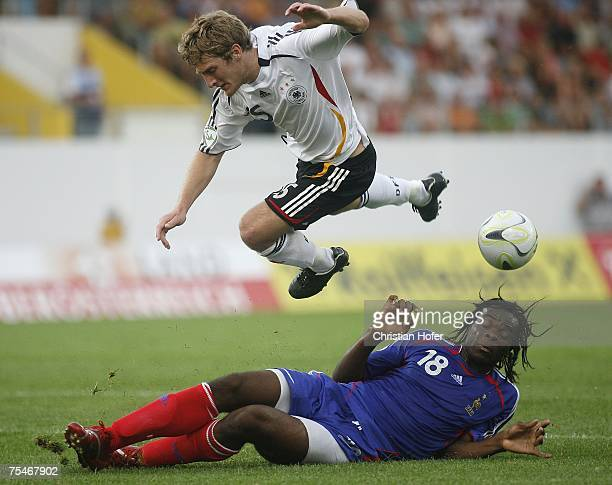 Christian Sauter of Germany and JeanYves Mvoto of France fight for the ball during the UEFA U19 European Championship match between Germany and...