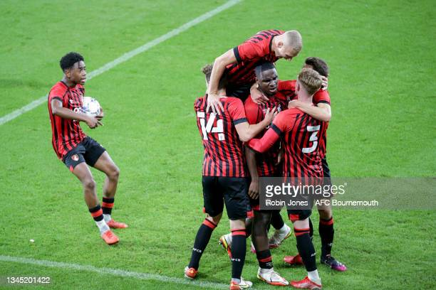 Christian Saydee of Bournemouth is mobbed by team-mates after he scores a late equaliser to make it 1-1 during the Premier League Cup match between...