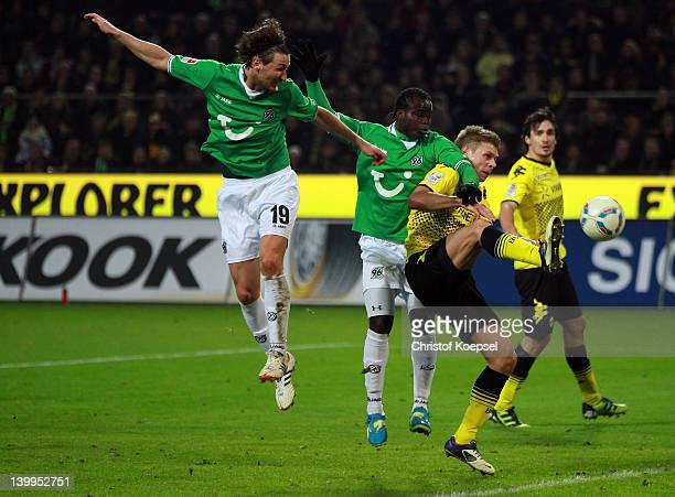 Christian Schulz Didier Ya Konan of Hannover and Lukasz Piszczek of Dortmund go up for a header during the Bundesliga match between Borussia Dortmund...