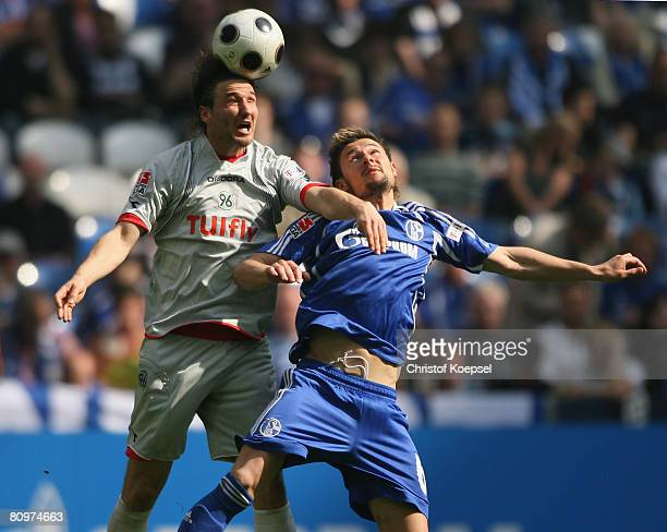Christian Schulz of Hannover battles for the ball with Albert Streit during the Bundesliga match between Schalke 04 and Hannover 96 at the Veltins...