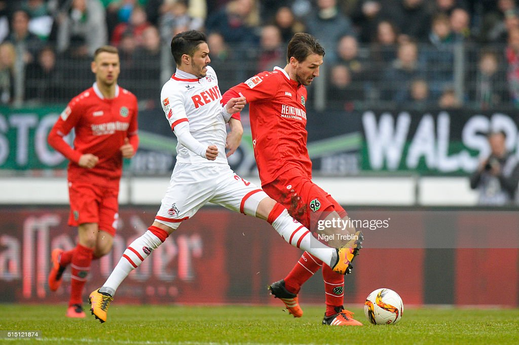 Christian Schulz of Hannover is challenged by Leonardo Bittencourt of Koeln during the Bundesliga match between Hannover 96 and 1. FC Koeln at HDI-Arena on March 12, 2016 in Hanover, Germany.