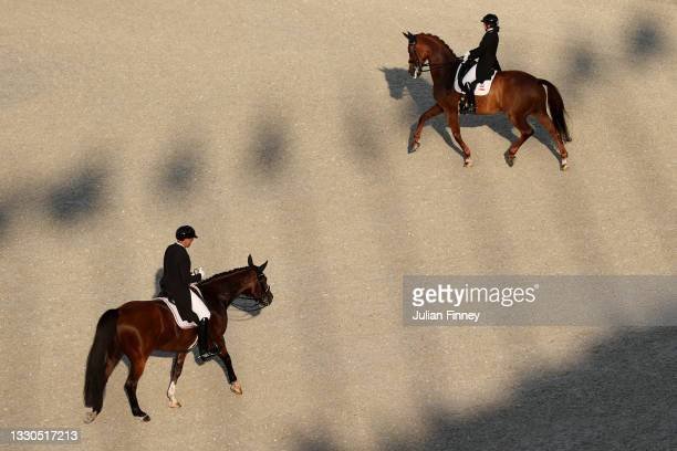 Christian Schumach of Team Austria riding Te Quiero SF leaves the arena as Caroline Chew of Team Singapore riding Tribiani arrives during the...