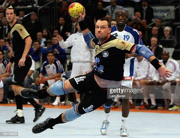Christian Schwarzer of Germany shoots during the IHF World Championship semi final game between Germany and France at the Cologne Arena on February 1...