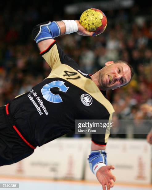 Christian Schwarzer of Germany throws at goal during the Men's Handball World Championship Group I game between Slovenia and Germany at the Gerry...
