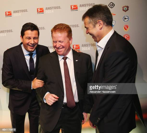 Christian Seifert CEO of DFL and DFL manager Andreas Rettig joke with Brian Sullivan chairman of SKY Germany during the DFL New Year's Reception at...