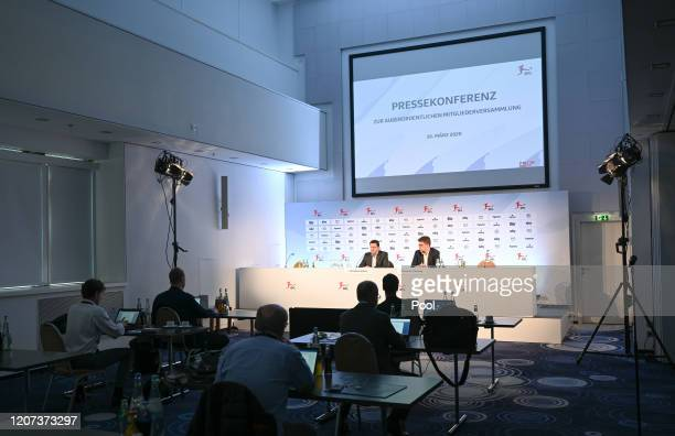 Christian Seifert , CEO of the German Football League , an Christian Pfenning, DFL spokesman, address the attending media during a press conference...