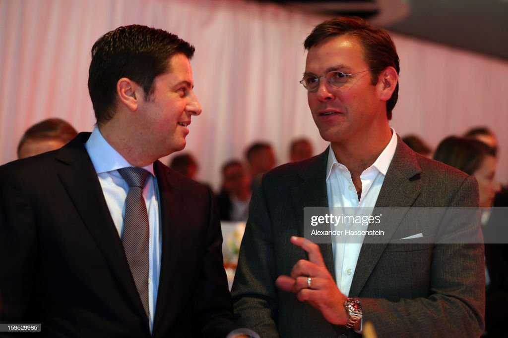 Christian Seifert (L), chairman of business for the DFL talks to James Murdoch, CEO News Corporation Europe and Asia, during the DFL new year's reception at the Thurn und Taxis Palais on January 15, 2013 in Frankfurt am Main, Germany.