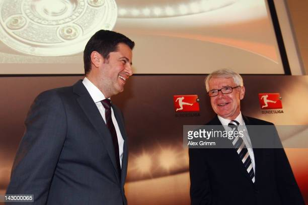 Christian Seifert , general manager of the German Football League , and DFL president Reinhard Rauball, laugh after a press conference after the...