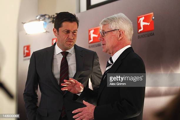 Christian Seifert , general manager of the German Football League , and DFL president Reinhard Rauball, chat after a press conference after the...