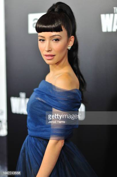 Christian Serratos arrives at the Premiere Of AMC's 'The Walking Dead' Season 9 at the DGA Theater on September 27 2018 in Los Angeles California