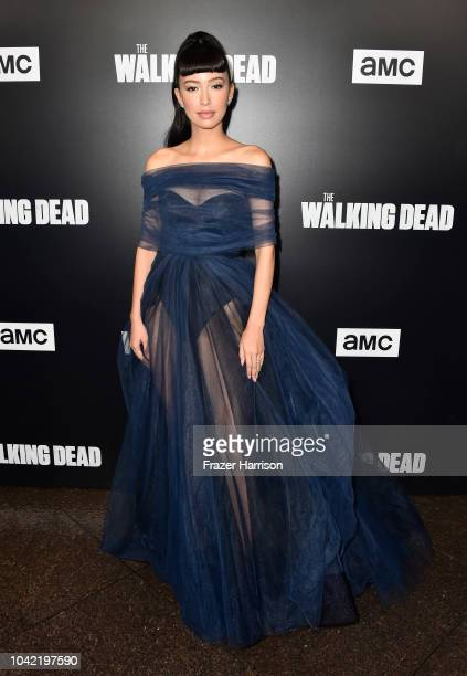Christian Serratos attends the Premiere of AMC's The Walking Dead Season 9 at DGA Theater on September 27 2018 in Los Angeles California