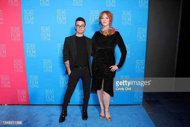 """Christian Siriano and Christina Hendricks attend the opening night red carpet and screening of """"Belfast"""" during the 24th SCAD Savannah Film Festival..."""