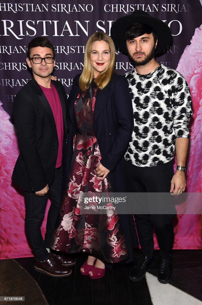 Christian Siriano, Drew Barrymore, and Brad Walsh celebrate the release of his book 'Dresses To Dream About' at the Rizzoli Flagship Store on November 8, 2017 in New York City.