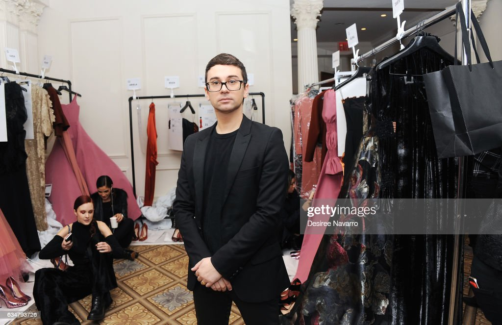 Christian Siriano poses backstage at his show during New York Fashion Week: The Shows at The Plaza Hotel on February 11, 2017 in New York City.