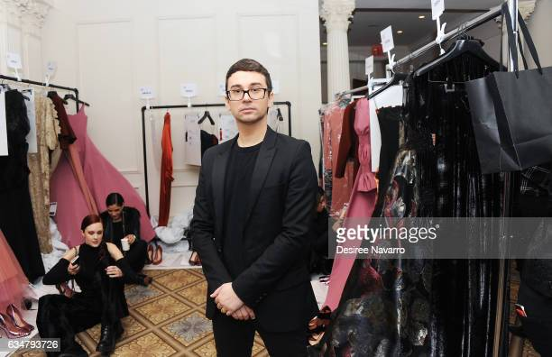 Christian Siriano poses backstage at his show during New York Fashion Week The Shows at The Plaza Hotel on February 11 2017 in New York City