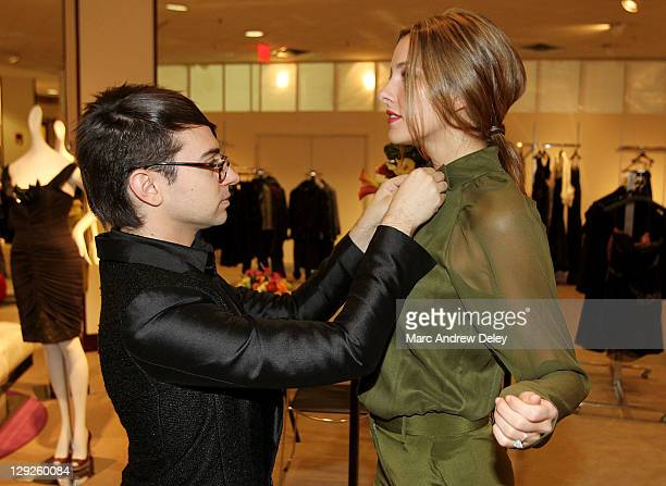 Christian Siriano styles a model during the Christian Siriano Spring 2012 Collection preview at Neiman Marcus Copley Place on October 14 2011 in...