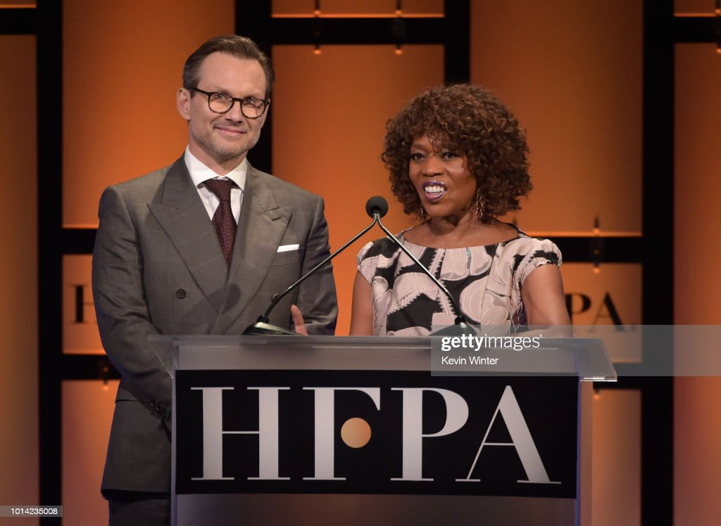 Christian Slater and Alfre Woodard speak onstage during the Hollywood Foreign Press Association's Grants Banquet at The Beverly Hilton Hotel on August 9, 2018 in Beverly Hills, California.