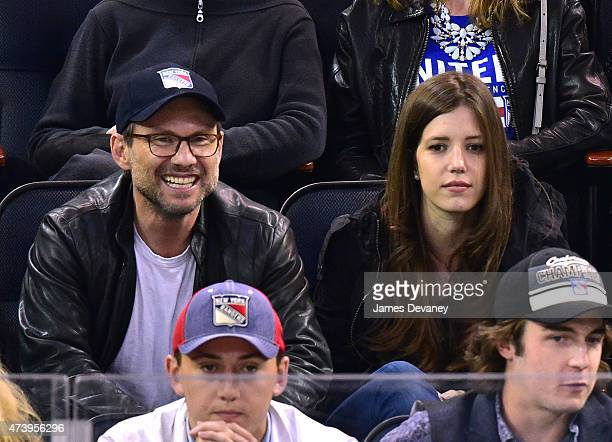 Christian Slater and Brittany Lopez attend the Tampa Bay Lightning vs New York Rangers playoff game at Madison Square Garden on May 18 2015 in New...
