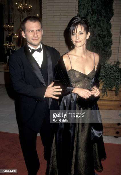 Christian Slater and Courteney Cox at the Barney's NY Store in Beverly Hills California