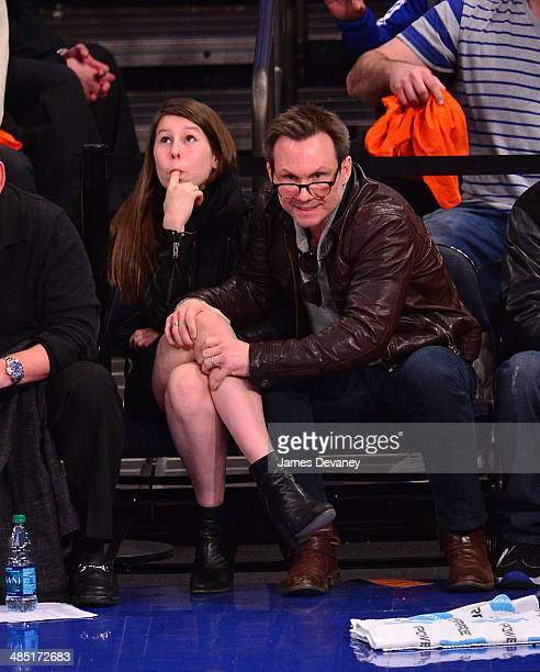 Christian Slater and daughter Eliana Sophia attend the Toronto Raptors vs New York Knicks game at Madison Square Garden on April 16 2014 in New York...