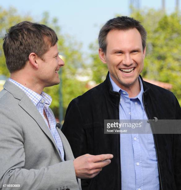 Christian Slater and Steve Zahn visit 'Extra' at Universal Studios Hollywood on February 24 2014 in Universal City California