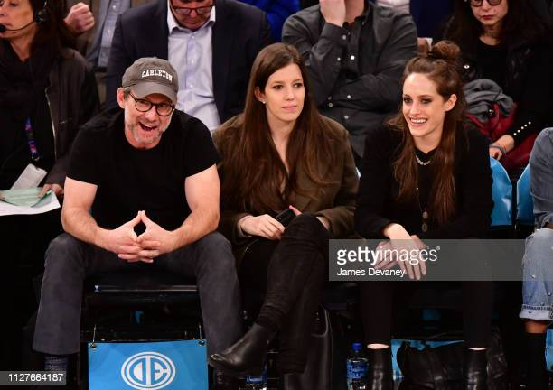 Christian Slater, Brittany Lopez and Carly Chaikin attend Orlando Magic v New York Knicks game at Madison Square Garden on February 26, 2019 in New...