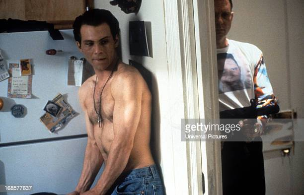Christian Slater prepares to ambush in a scene from the film 'Kuffs' 1992