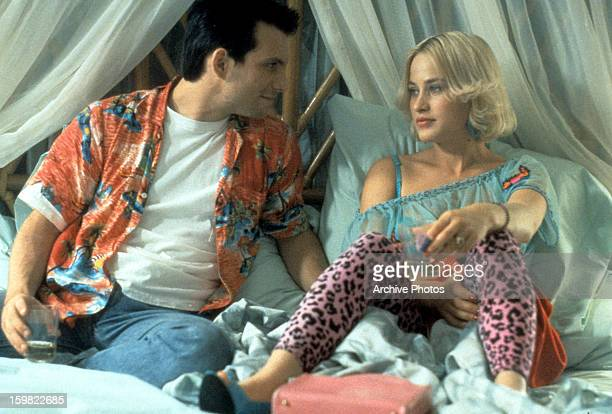 Christian Slater sits in bed with Patricia Arquette in a scene from the film 'True Romance' 1993