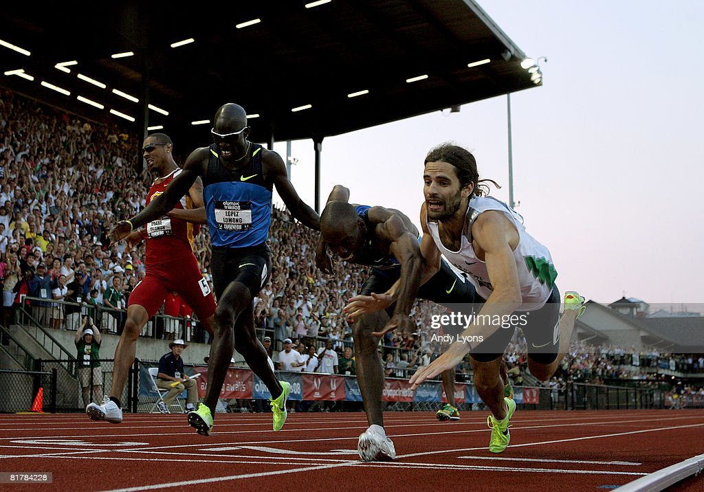 Christian Smith (far right) dives over the finish line ahead of (L-R) Duane Solomon, Lopez Lomong and Khadevis Robinson in the men's 800 finals during day four of the U.S. Track and Field Olympic Trials at Hayward Field on June 30, 2008 in Eugene, Oregon. Smith came in third place and earns a spot on the Olympic team.