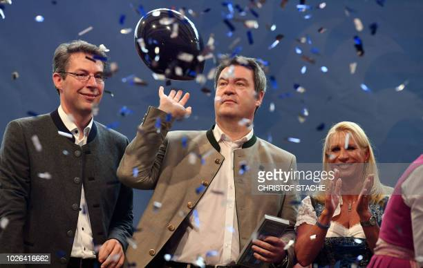 Christian Social Union General Secretary Markus Blume Bavarian Prime Minister Markus Soeder and his wife Karin Soeder react on stage during the...