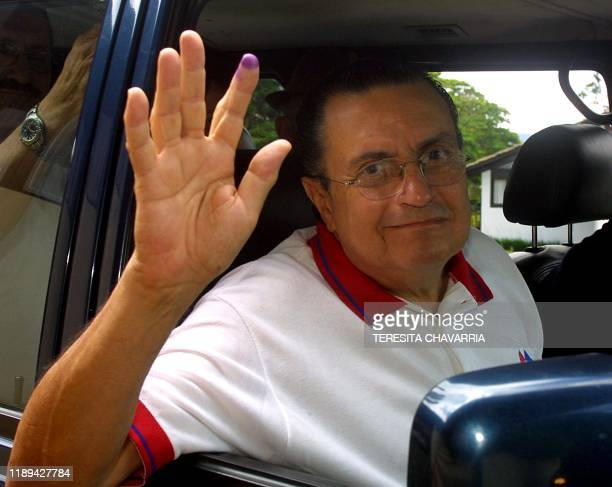Christian Social Unity Party candidate Abel Pacheco greets people 10 June 2001 on his way to San Jose Costa Rica The psychiatrist and TV commentator...